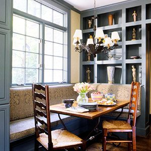 banquette in a blue nook with shelving
