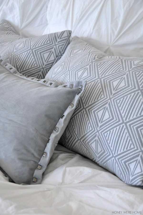 neutral master bedroom, gray and white pillows and bedding