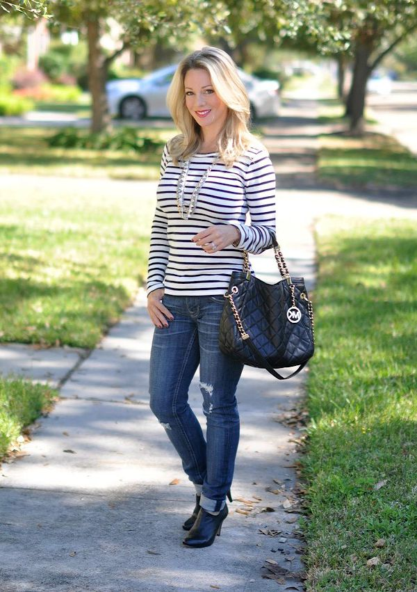 Fall fashion - distressed jeans, striped top, statement necklace, MK quilted bag, booties