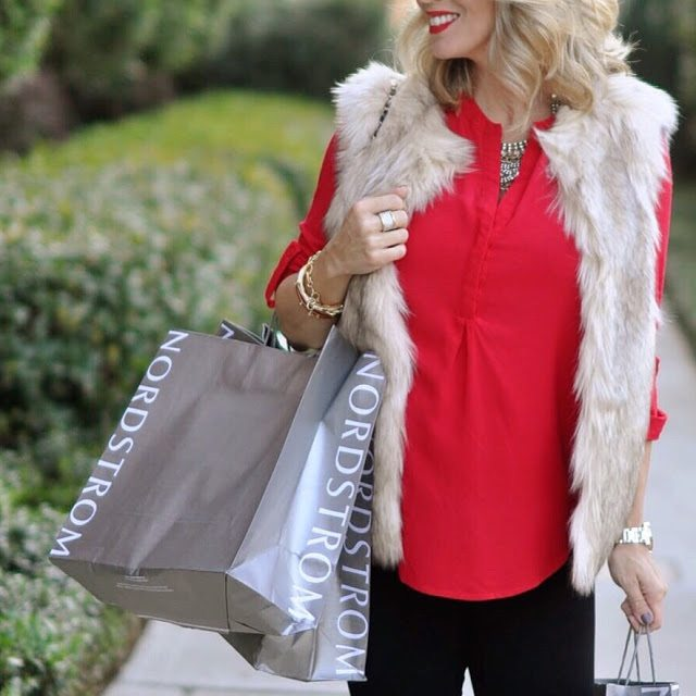Faux fur vest!  SHUT THE FRONT DOOR, it's on sale for 45% off!  Only $65 now, was $125!