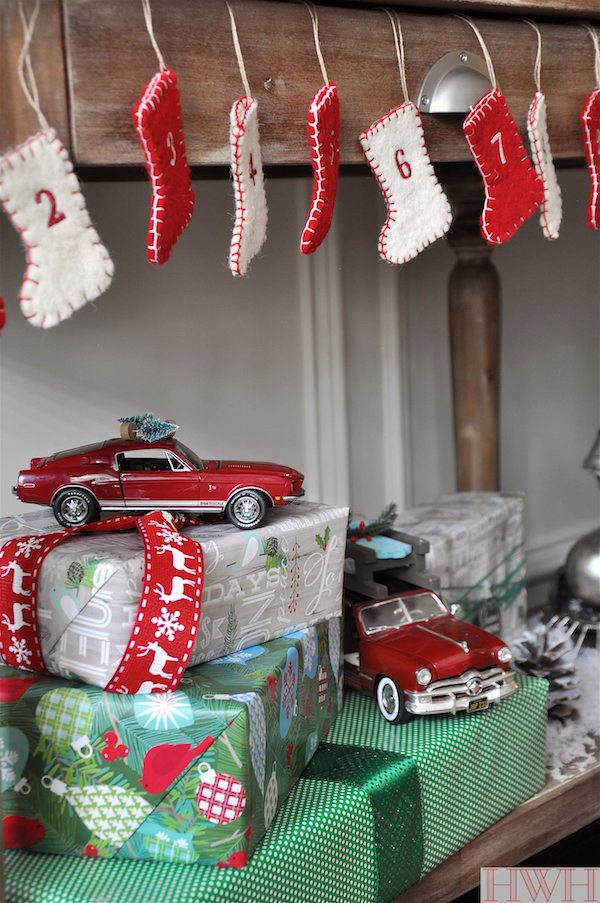 Festive holiday decor using real toys like these red cars and sled & tree ornaments | Honey We're Home
