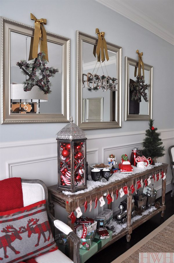 Festive holiday with Peace and Stars hung from gold ribbon on mirrors | Honey We're Home