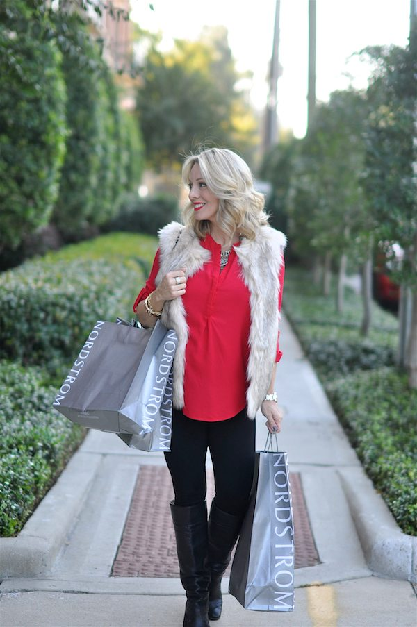 Holiday outfit- red tunic top, black leggings, knee high boots, faux fur vest