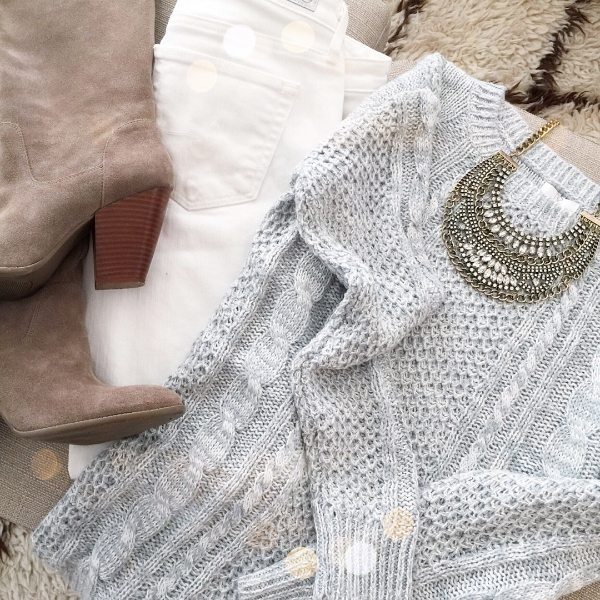 Cable knit sweater, white jeans, boots and necklace.