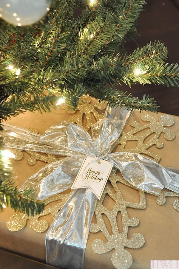 Festive Christmas gift wrap with large glittered snowflake