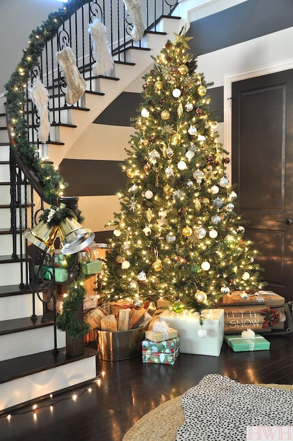 Sparkly Christmas Tree with metallic ornaments and faux fur stockings | Honey We're Home