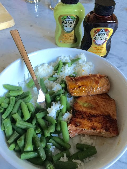 Grilled fish with rice and veggies.