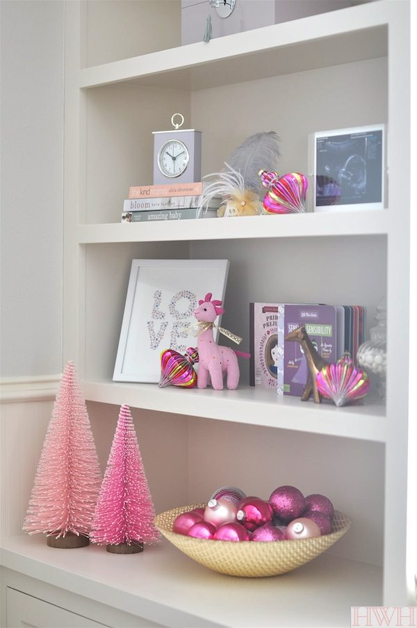 Festive holiday nursery with pink Christmas trees and ornaments. | Honey We're Home
