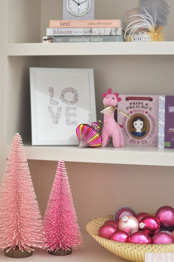 Festive holiday nursery with pink Christmas trees and ornaments in a bowl.   Honey We're Home