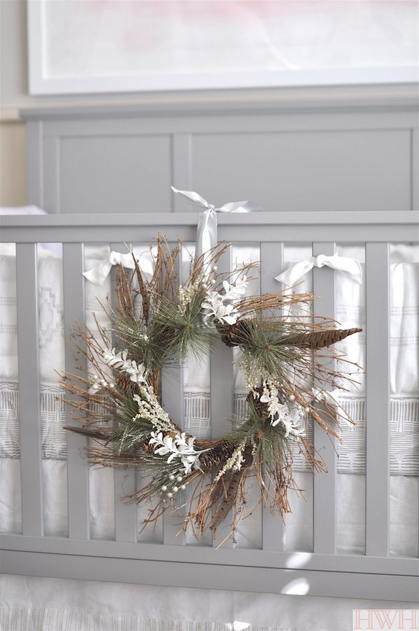 Pretty holiday wreath hung from crib in nursery.  Just lovely!   Honey We're Home