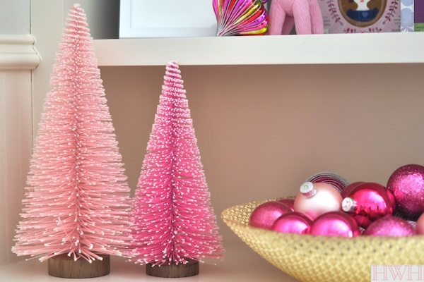 Festive holiday nursery with pink and gold decorations. Pink Christmas trees and ornaments in a bowl | Honey We're Home