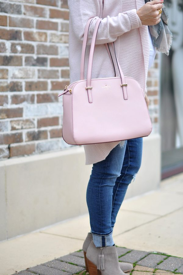 Perfect size pink Kate Spade bag with scarf and pink 'cocoon' cardigan, jeans and booties.