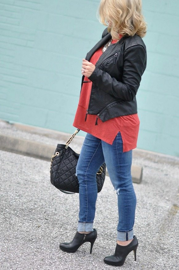 Faux leather jacket, top, Michael Kors bag and black booties.