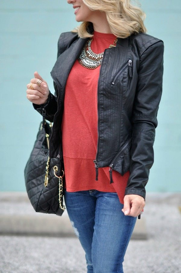 Pregnancy update 23 weeks.  Leather Jacket, jeans, bag and necklace.