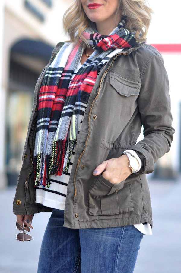 Military style jacket, striped v-neck top and plaid scarf.