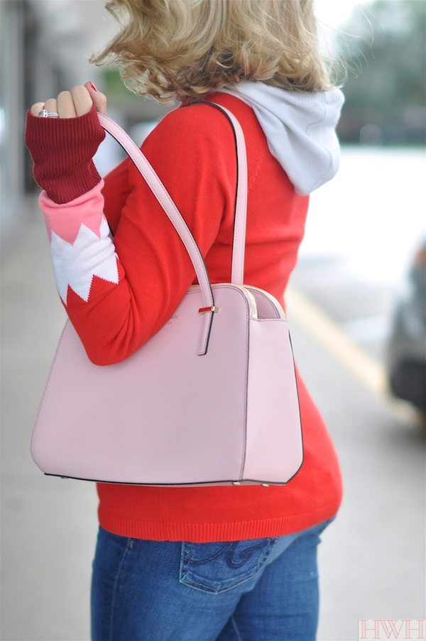 Beautiful pink Kate Spade bag and red hooded sweater with pink and white accents on sleeves.