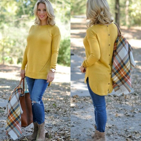 Yellow button-back sweater and plaid scarf.