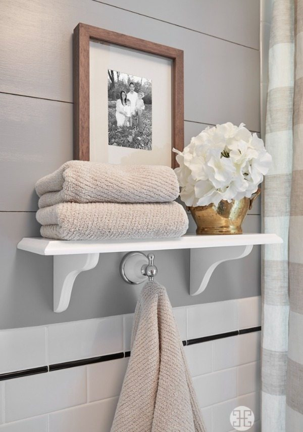 Beautiful white open shelving in neutral bathroom   A Well Dressed Home