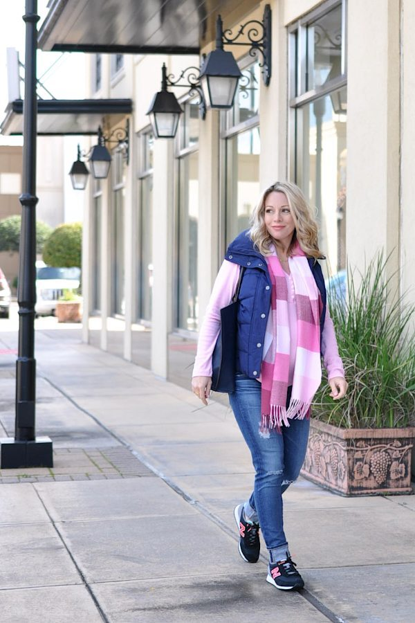 Fall/Winter fashion - distressed jeans, pink top, navy puffer vest and cute sneakers - cute weekend maternity outfit    #dressingthebump #bumpstyle #maternitystyle