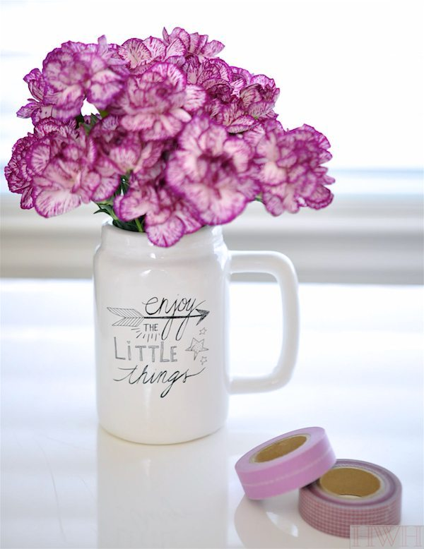 Love keeping fresh flowers in unexpected vessels like this mason jar mug