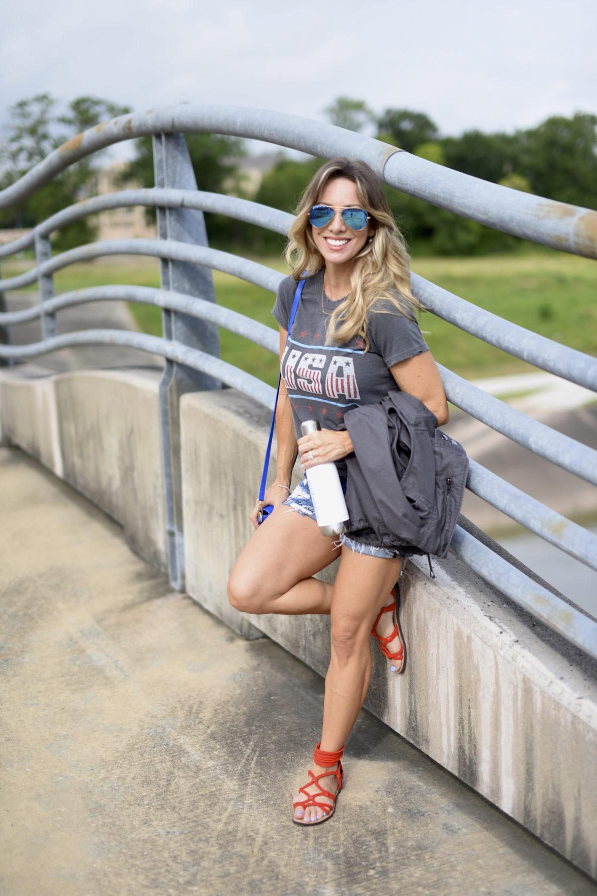USA graphic tee jean shorts blue bag