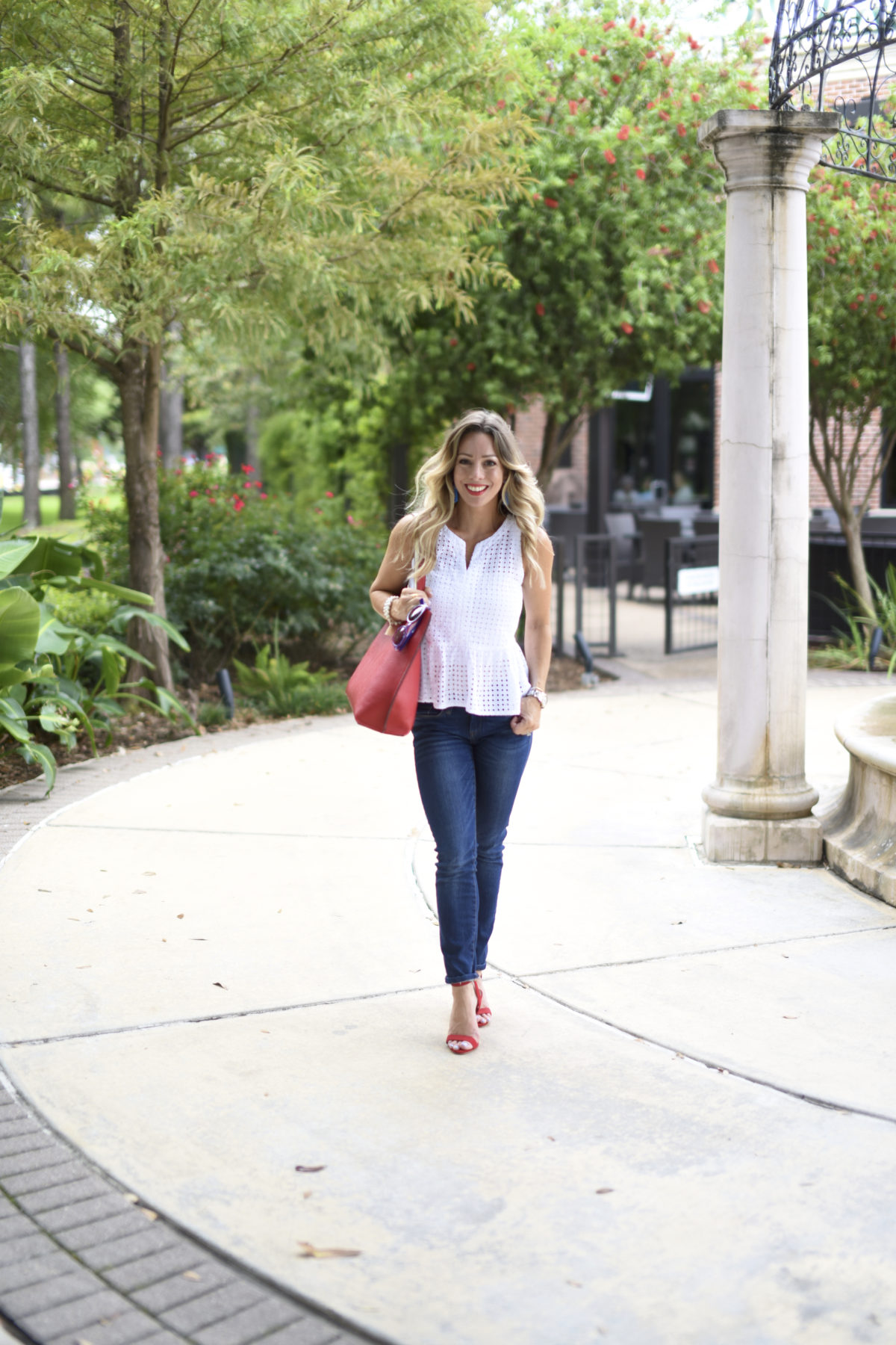 white eyelet top jeans red heels
