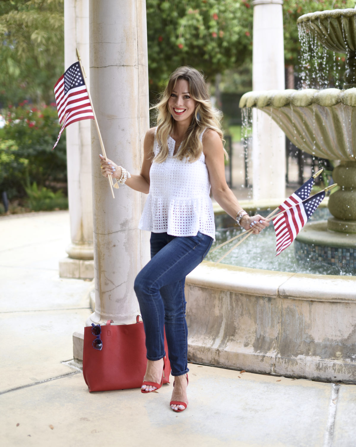 white eyelet top jeans red shoes