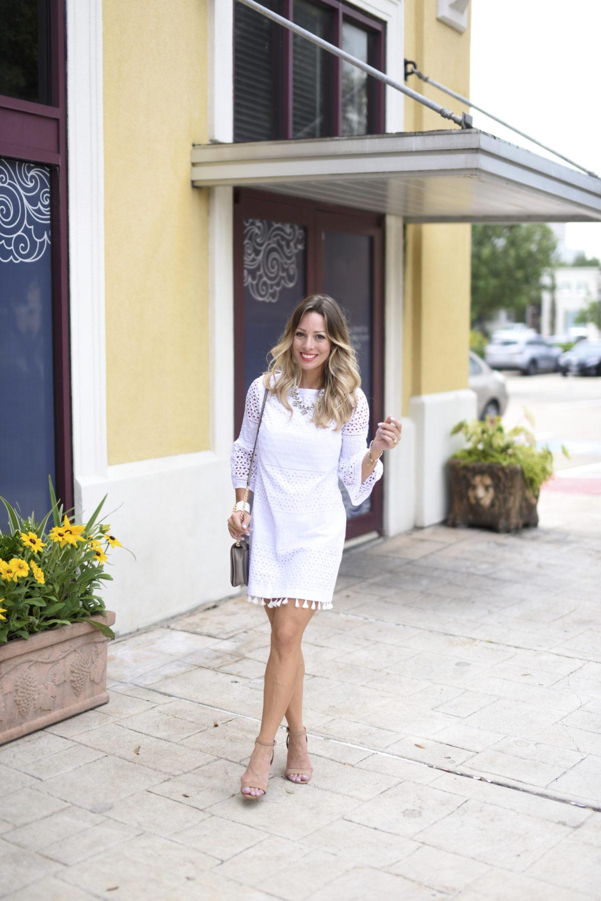 white eyelet dress with tassels