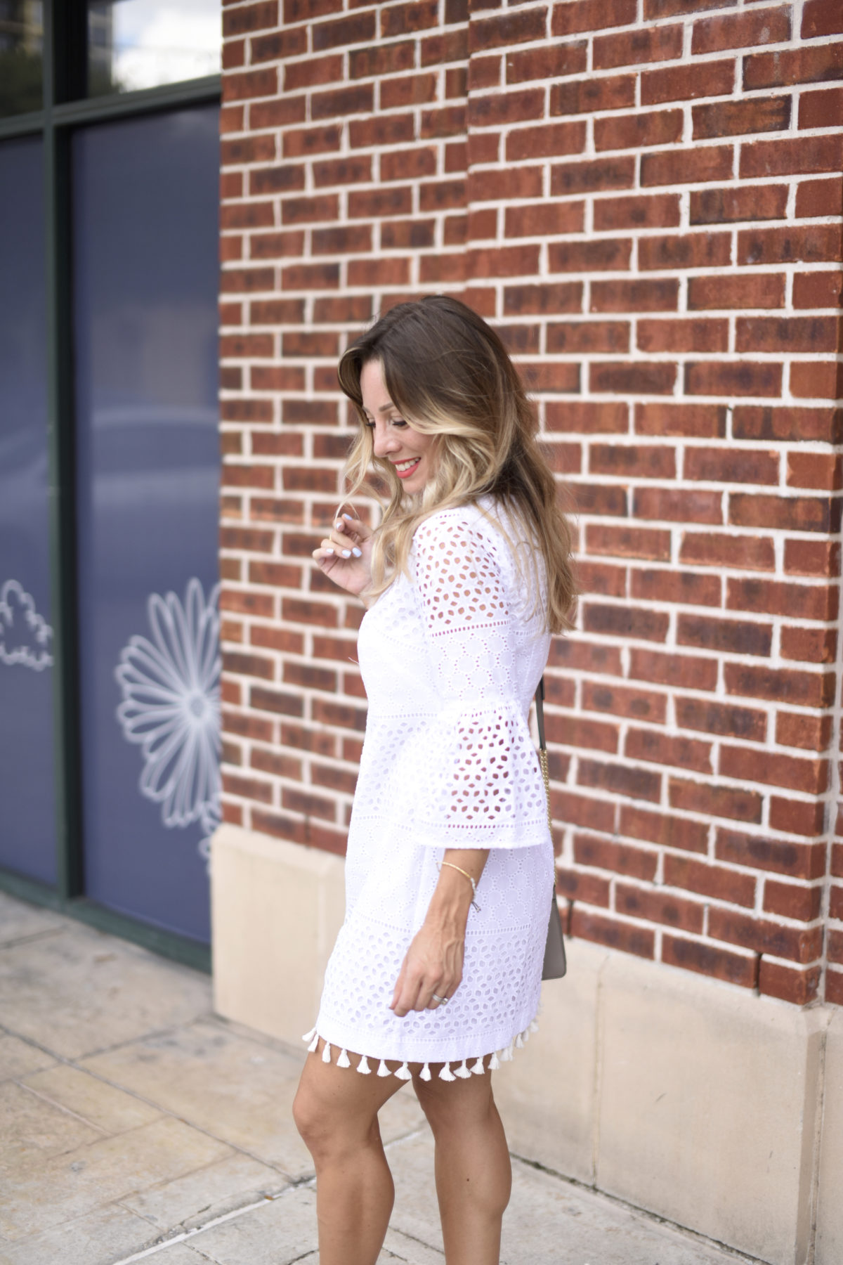 white eyelet dress with tassels