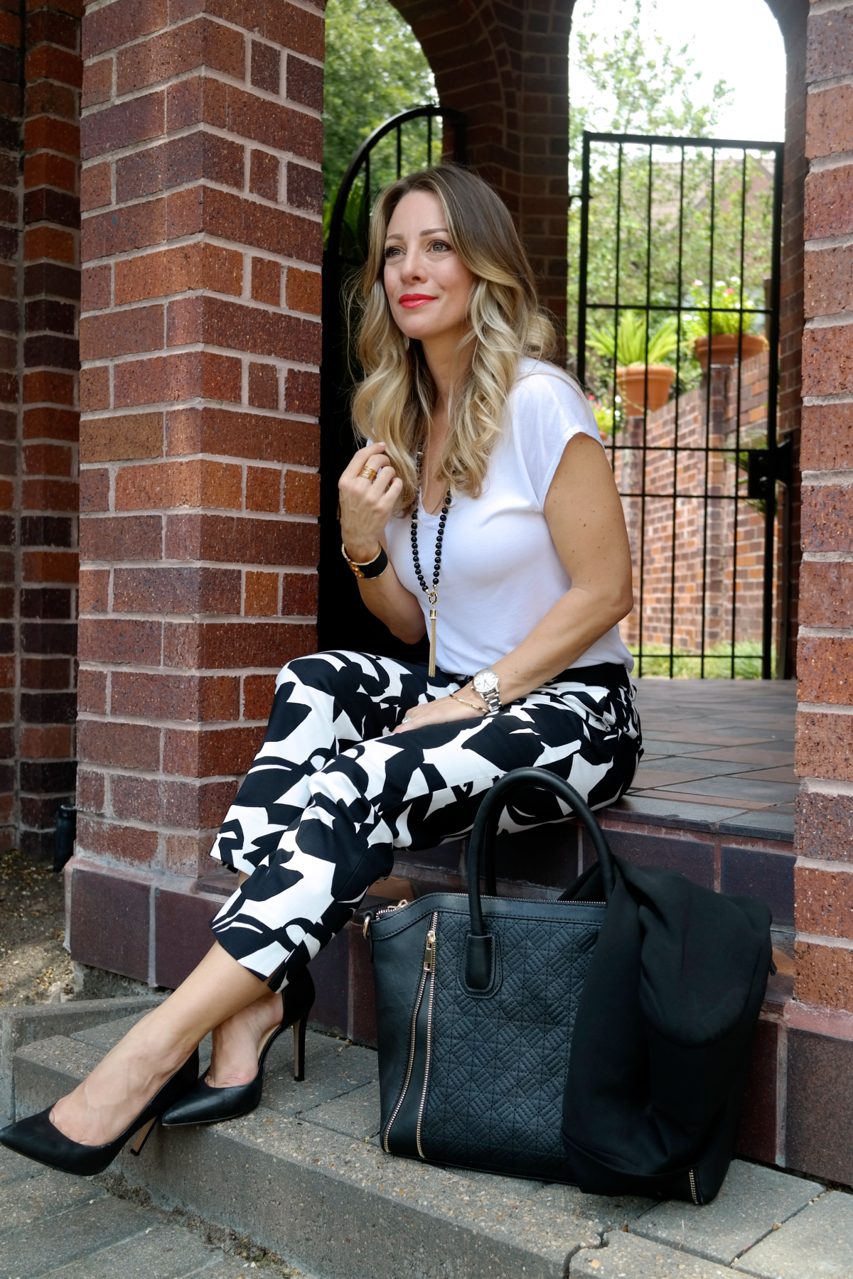 print pants black blazer white tee