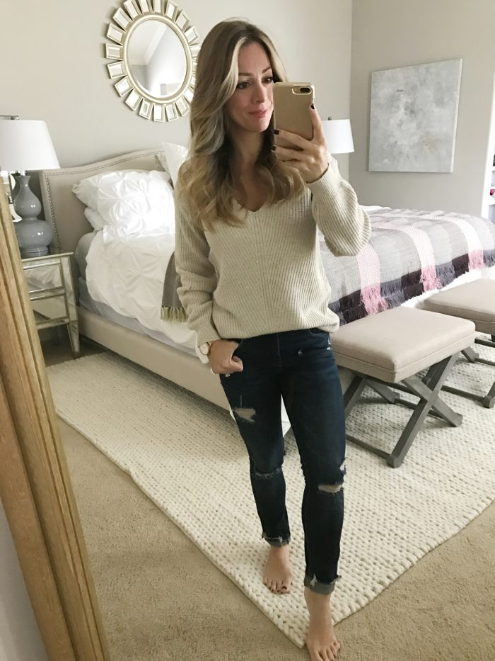 Fall fashion - dressing room try on, ripped jeans and v-neck sweater #fallfashion