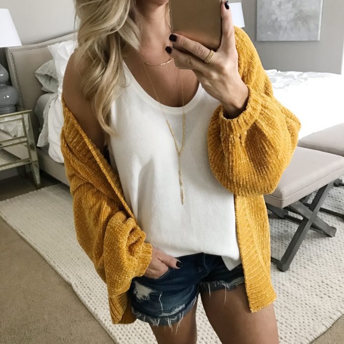 white tank yellow cardigan
