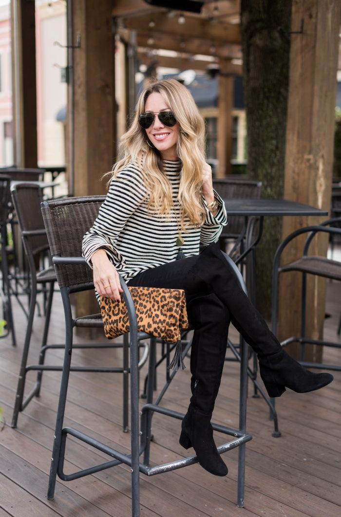 Thanksgiving Outfit - black jeans, boots, striped tunic and leopard clutch