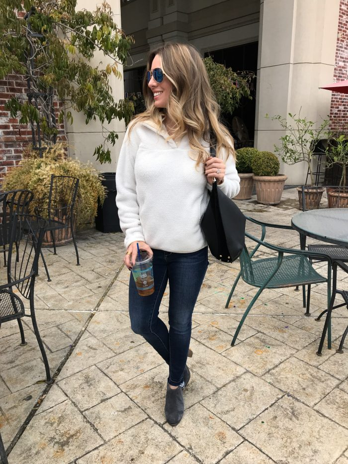 Casual Outfit - Patagonia pullover with high waist skinny jeans and booties