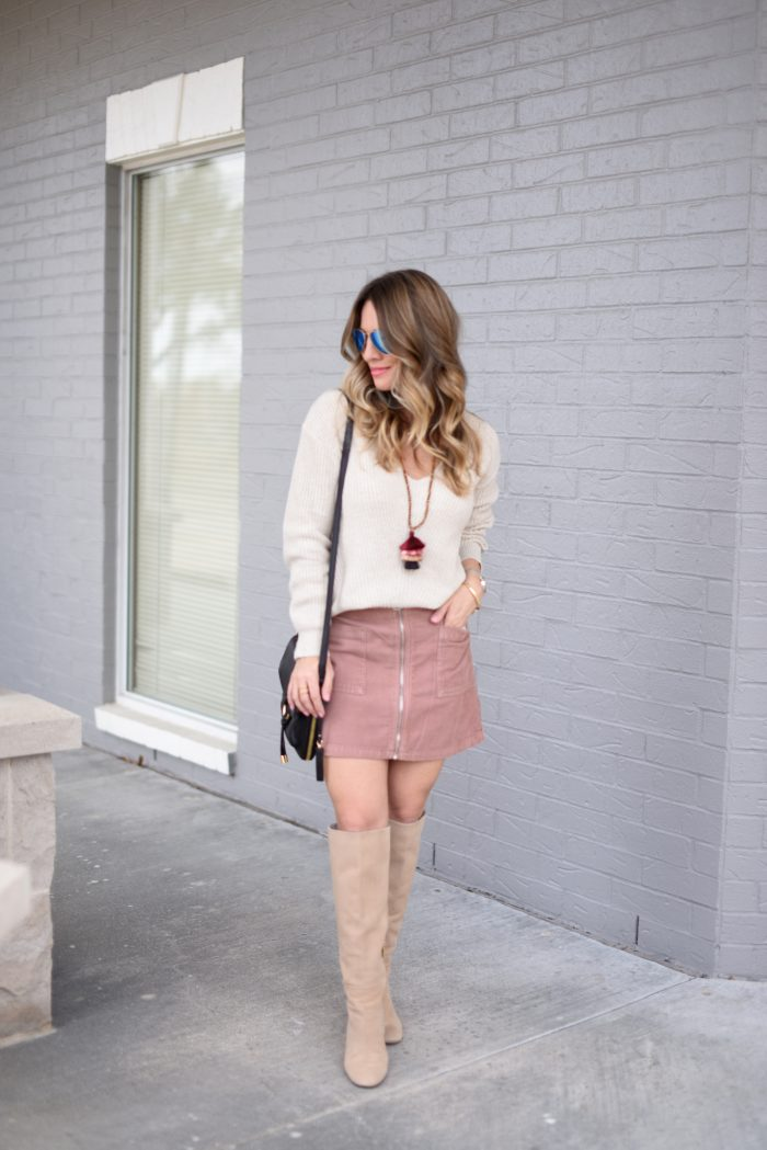 pink corduroy skirt and v-neck sweater with boots