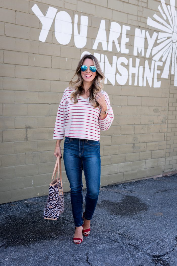 striped top and jeans with red heels