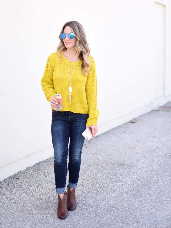 yellow cable knit sweater and jeans with booties