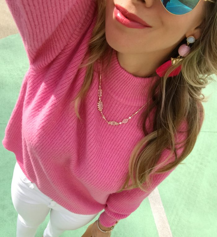 Pink sweater and tassel earrings