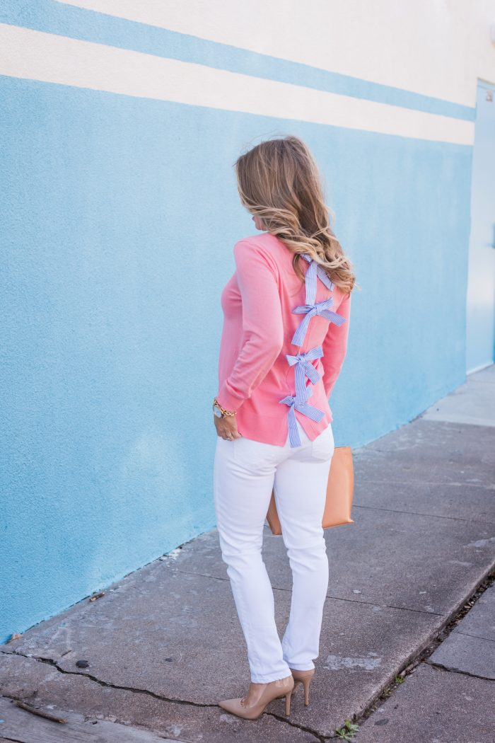 Transitional Spring Outfit- bow back sweater with white jeans, heels and tan bag