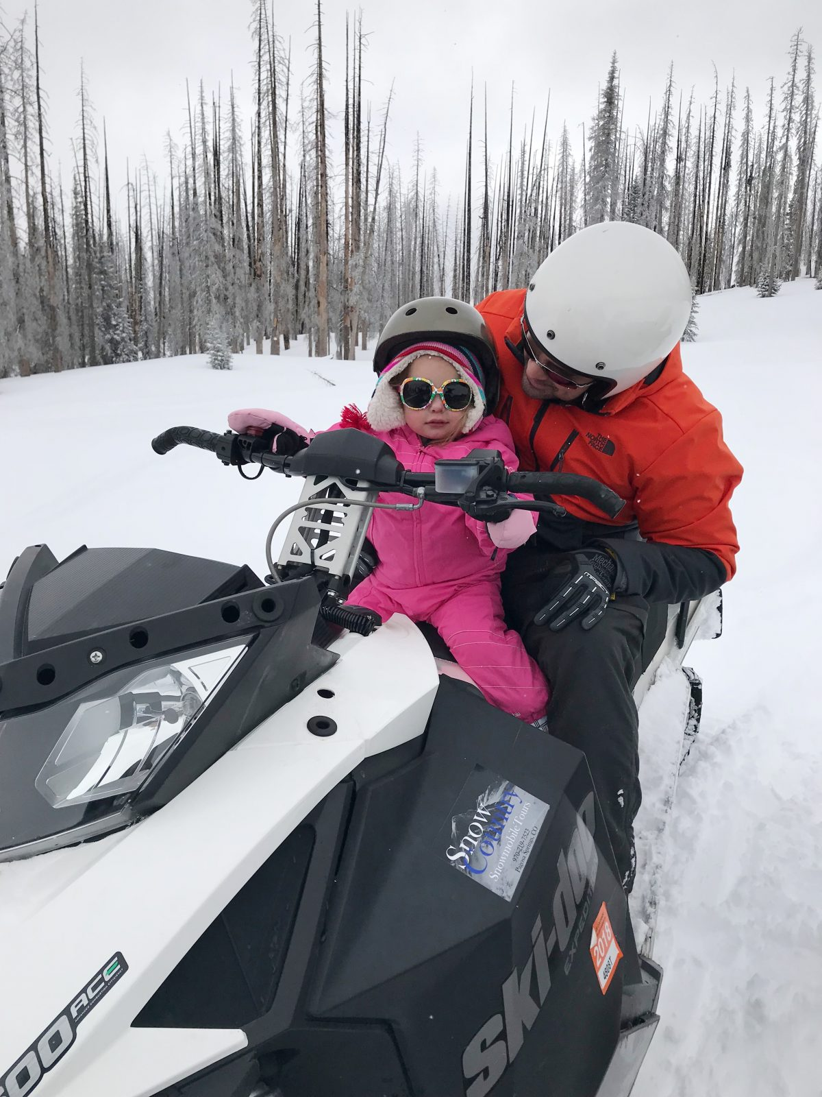 Family ski trip with a toddler - snowmobiling