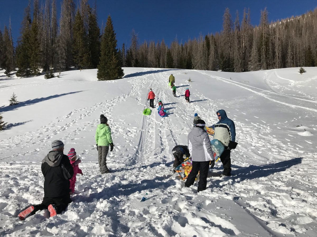Family ski trip with toddler - sledding (1)