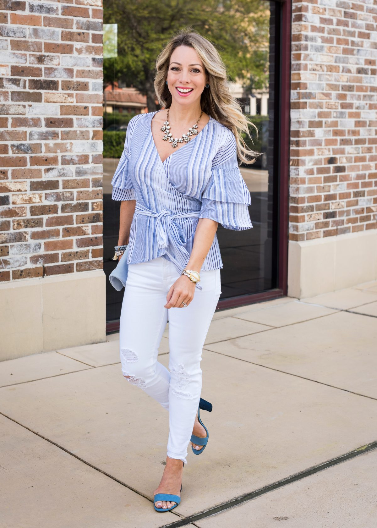 Spring Outfit - blue wrap ruffle sleeve top and white jeans 1