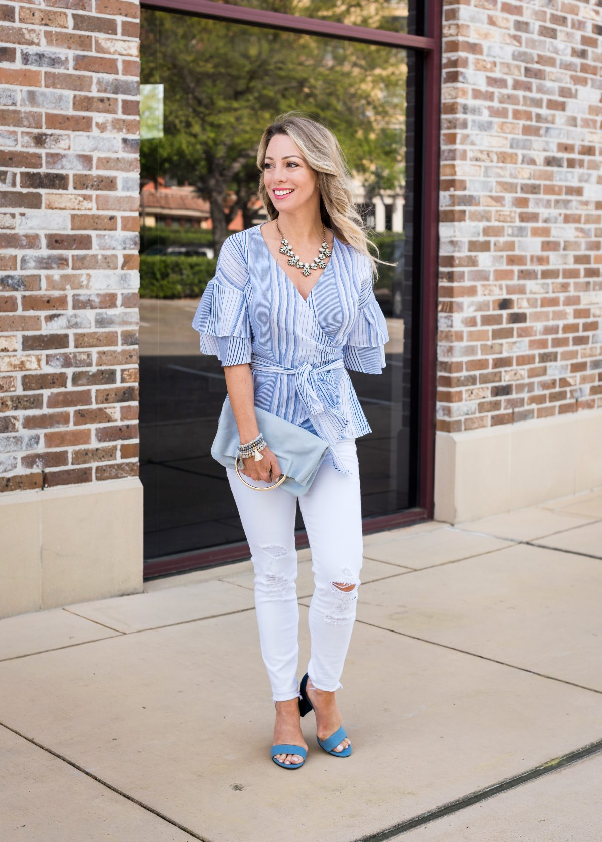 Spring Outfit - blue wrap ruffle sleeve top and white jeans 2
