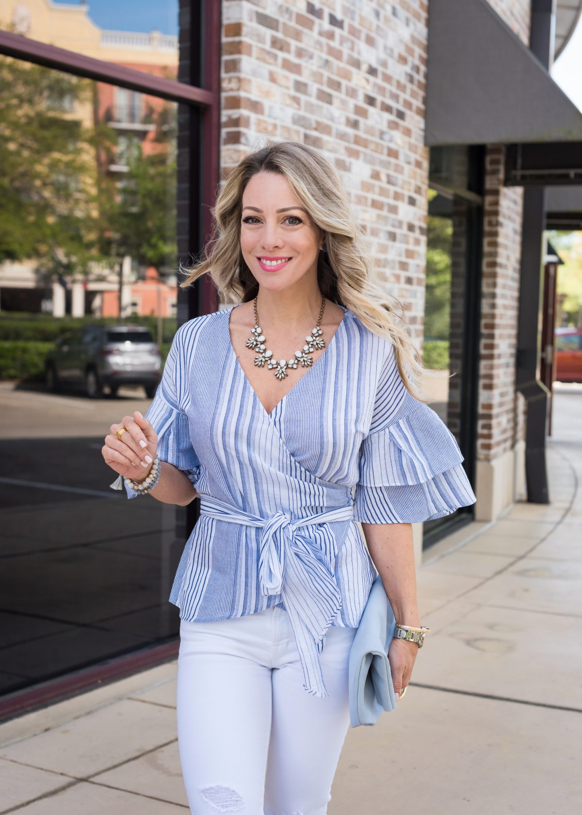 Spring Outfit - blue wrap ruffle sleeve top and white jeans 3