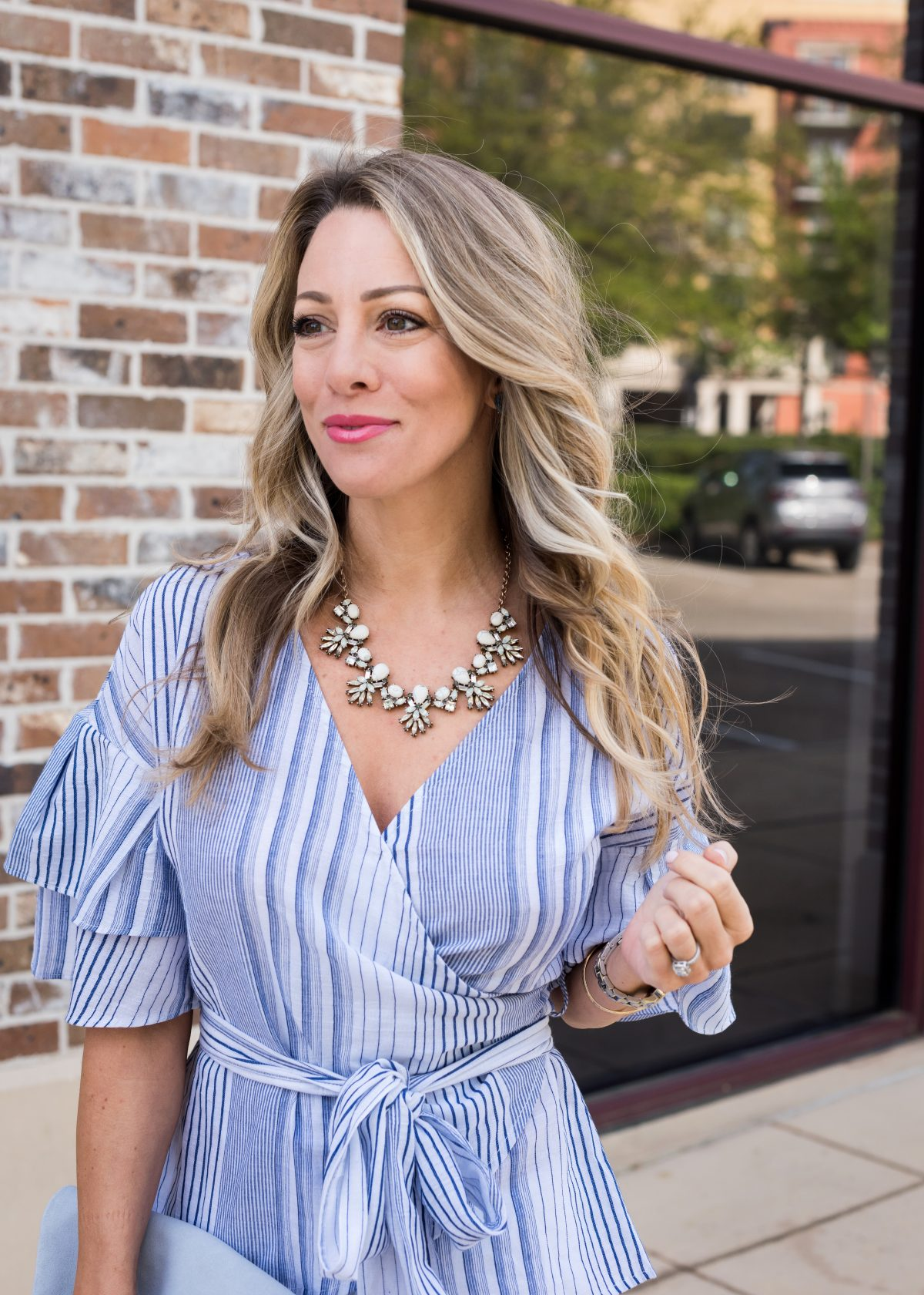 Spring Outfit - blue wrap ruffle sleeve top and white jeans 6