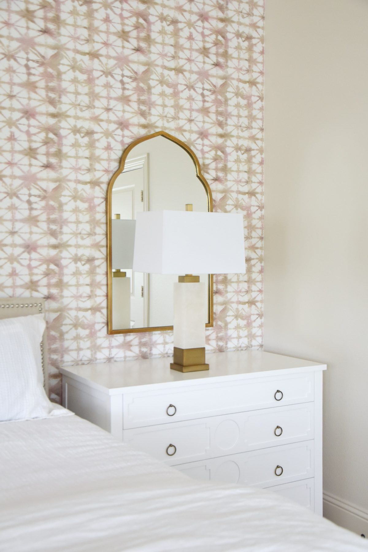Bedroom lamp and gold arched mirror
