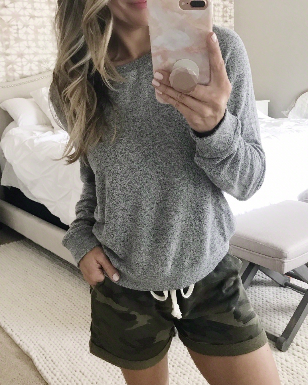 Camo shorts and grey pullover