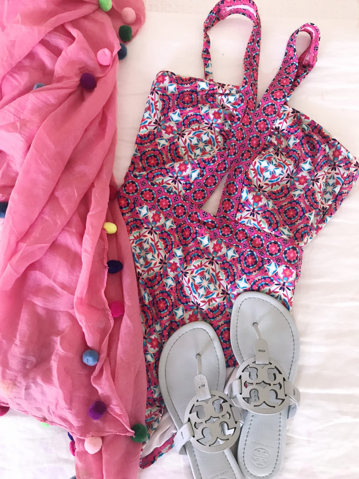 Pom pom scarf coverup with swimsuit and tory burch miller sandals