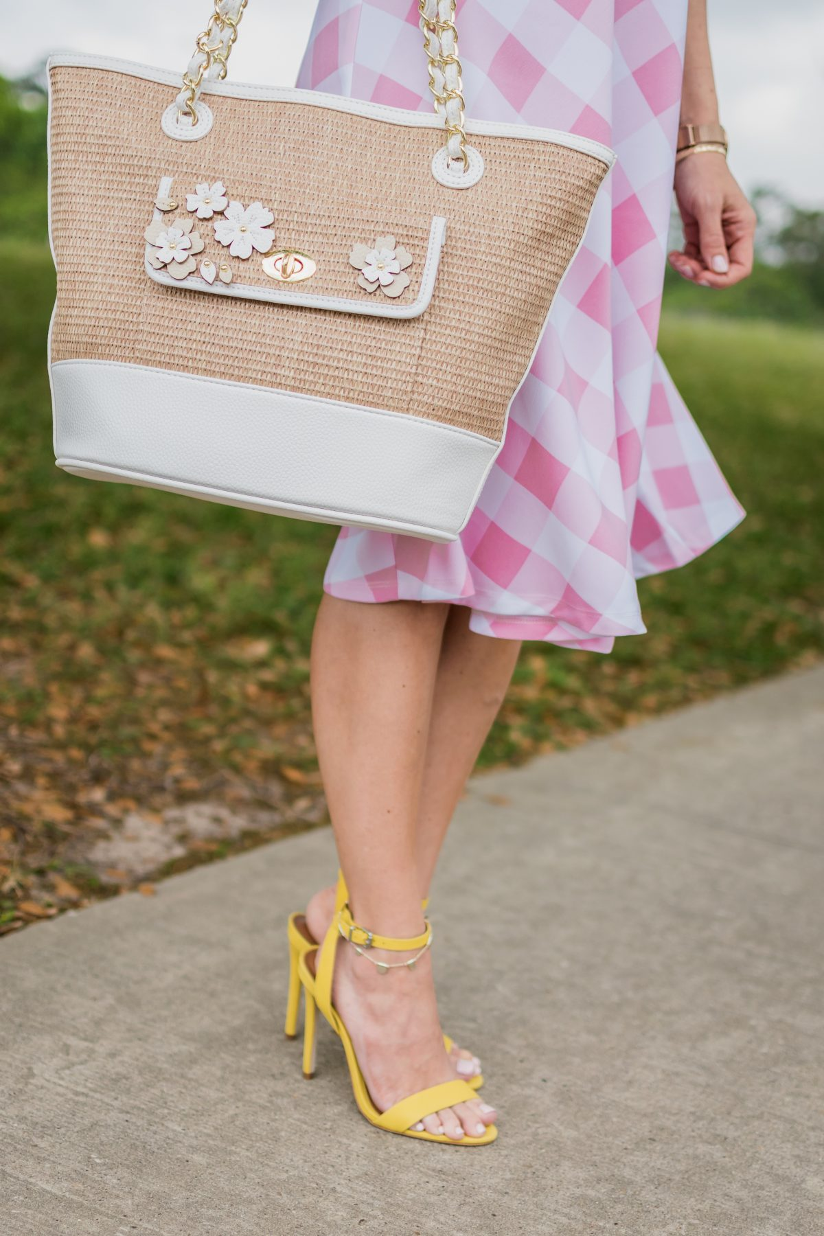 white and straw tote