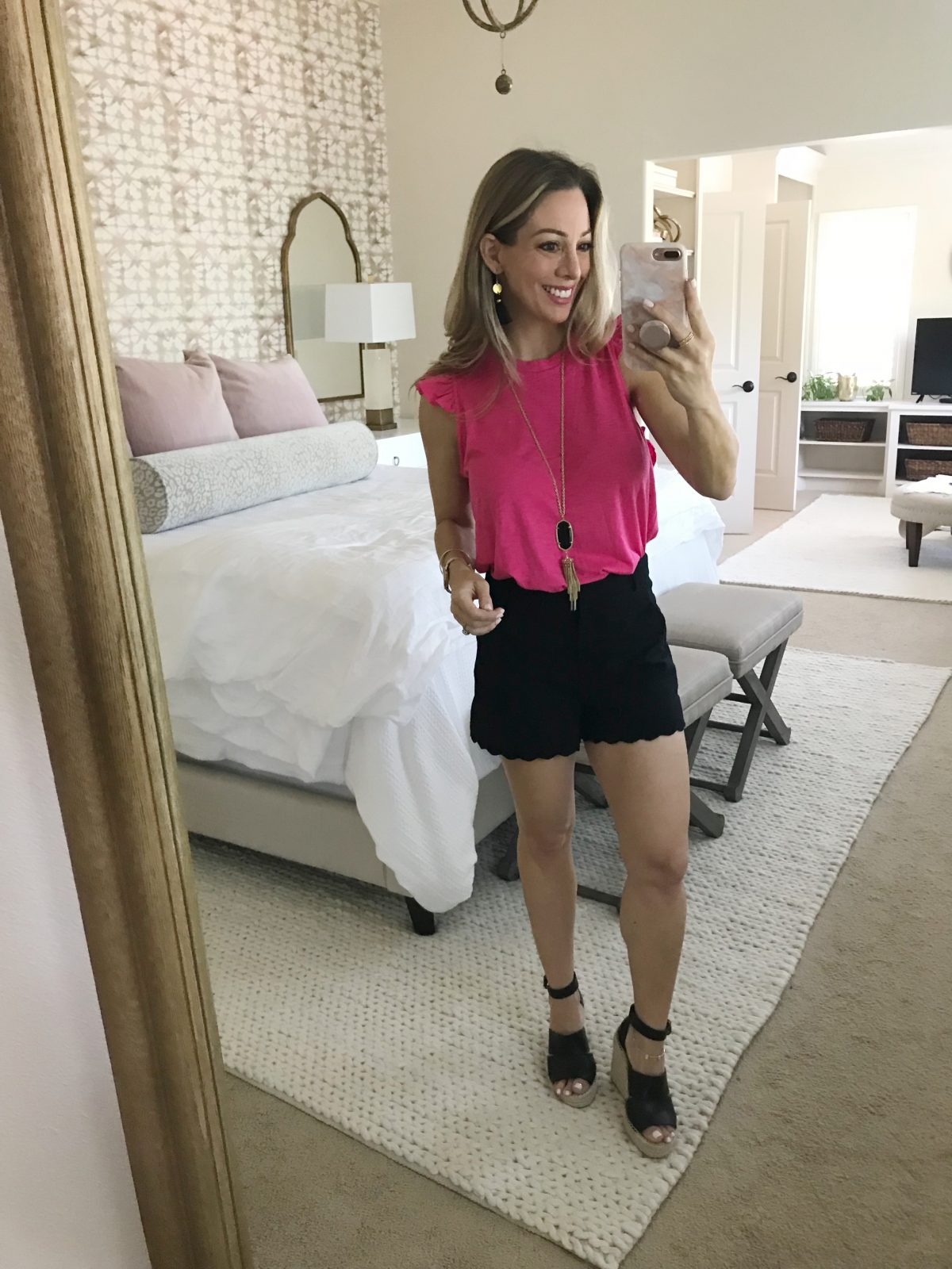 Hi Sugarplum x Gibson pink flutter sleeve top and black scallop shorts